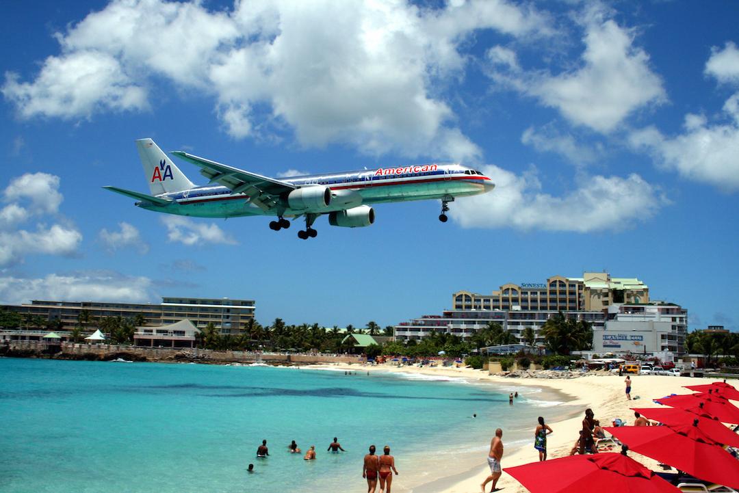 plane-flying-over-beach-st-marteen