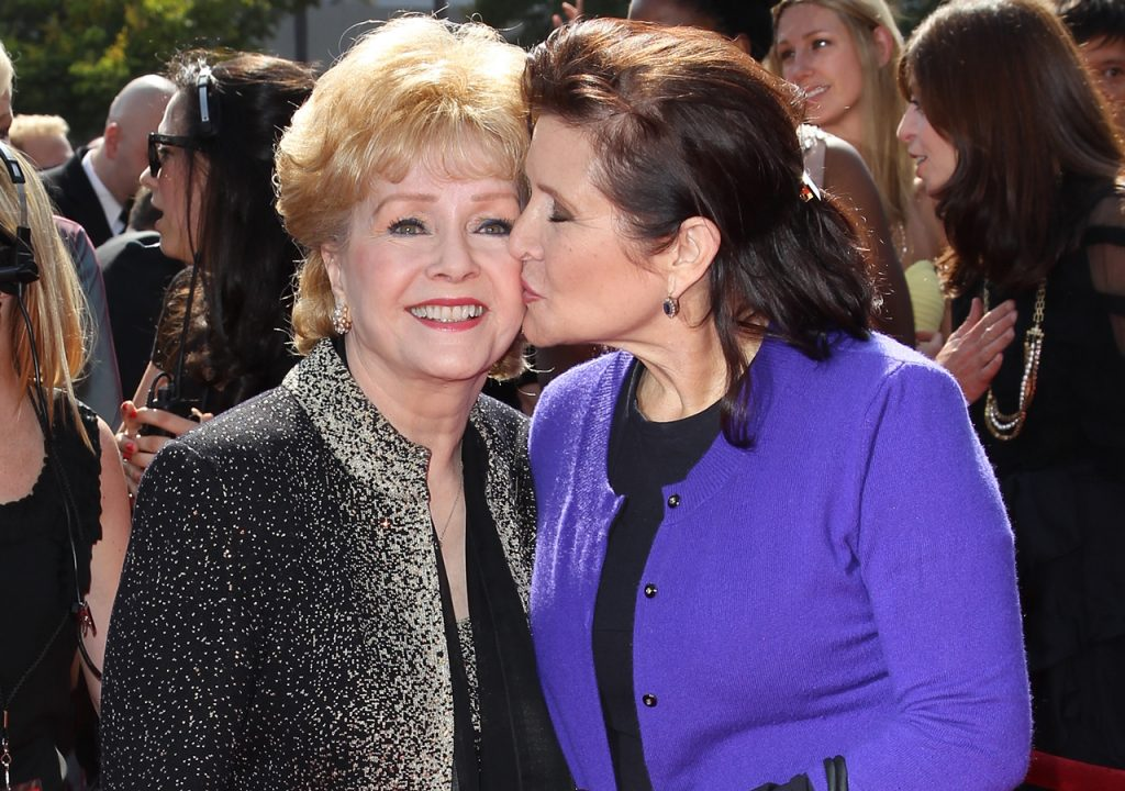 Debbie Reynolds (L) and Carrie Fisher attend the 2011 Primetime Creative Arts Emmy Awards at Nokia Theatre on September 10, 2011 in Los Angeles